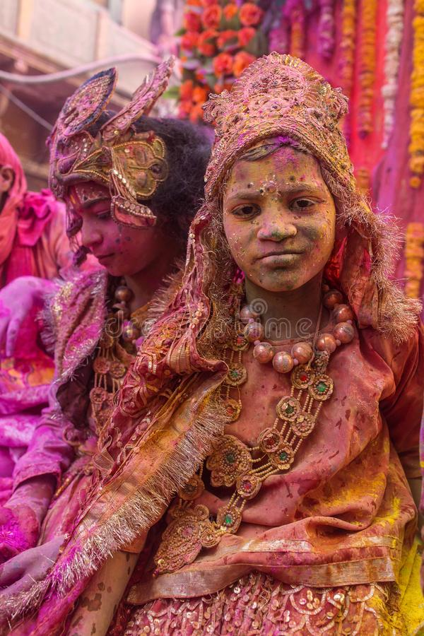 Holi celebration, Vrindavan and Mathura, India. Mathura, India - March 23, 2016: Indian children dressed as Hindu deities participate during colourful Holi stock photos