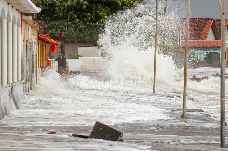 Strong waves hit the streets. Matinhos, Parana, Brazil - June 4, 2011: strong waves hit the streets of the neighborhood known as PICO, in the city of Matinhos royalty free stock images
