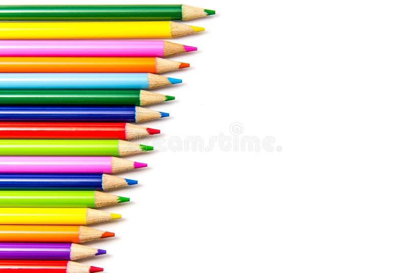 Matite colorate nelle righe fotografie stock