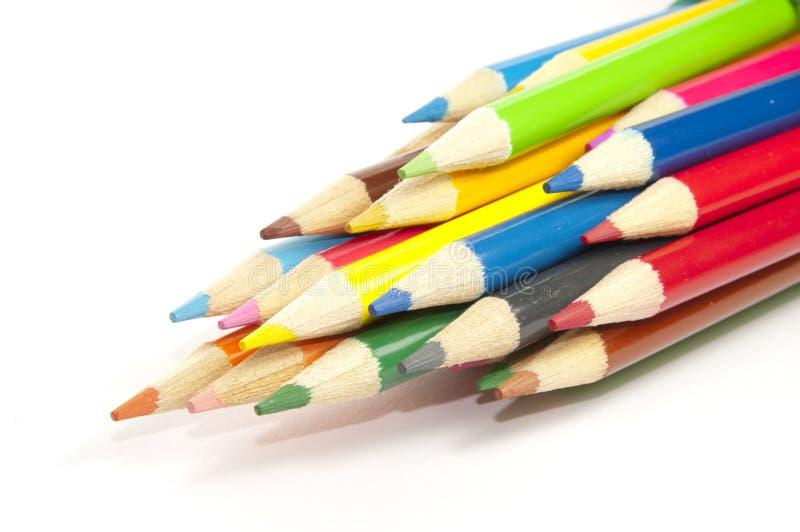 Matite colorate su bianco fotografia stock