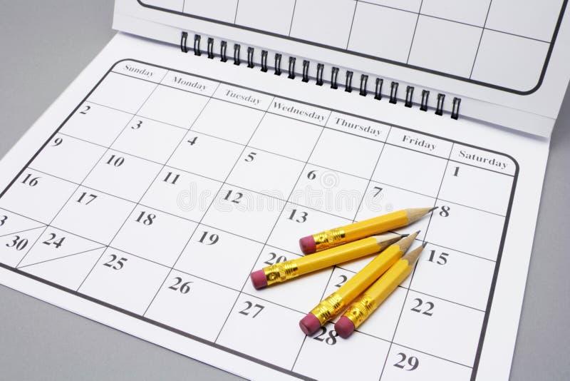 Matite sul calendario immagini stock libere da diritti