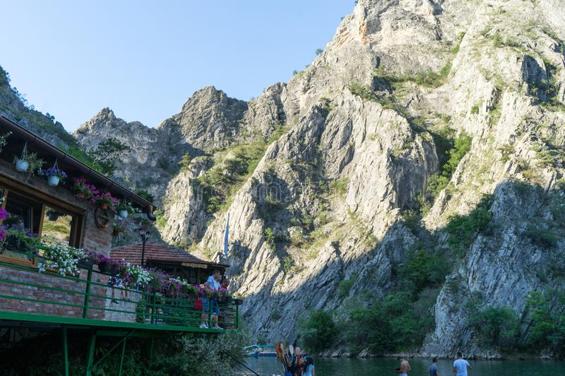 Matka Canyon, Skopje / Macedonia - July 06 2019: Group of people doing kayak activity in the balkans in summer. Men having fun. With canoe in a river, journey royalty free stock photo