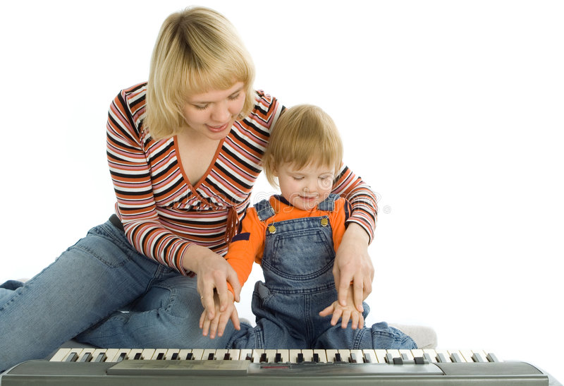 matka dziecka fortepianowa uczy sztuki obraz royalty free