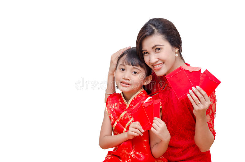 Matki i dziecka mienia paczki czerwony pieniądze zdjęcie royalty free