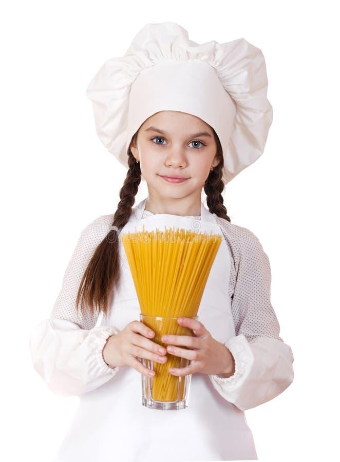 Matlagning och folkbegrepp - le lilla flickan i kockhatt arkivbilder