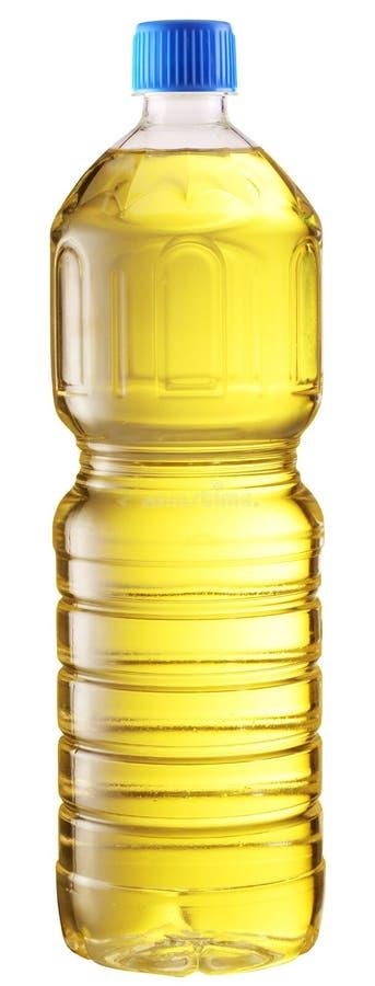 Matlagningolja i en plastic flaska. arkivfoton