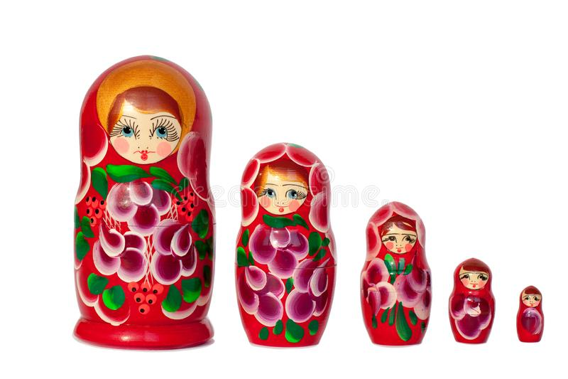 Matreshka Rosyjskiej lali pamiątkarski jaskrawy czerwieni, purpur i zieleni kwiatów wzór na białym tle, odizolowywał zbliżenie obrazy stock