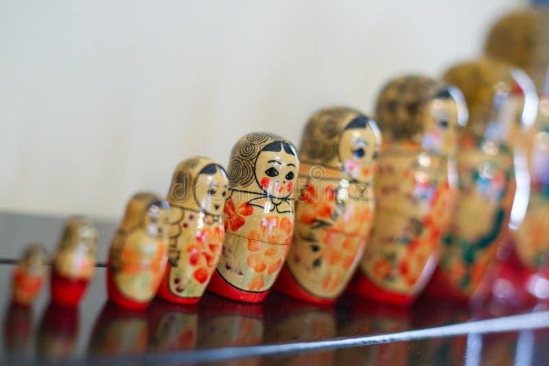 Matrioska traditional russian wooden dolls. Colorful Matrioska traditional russian wooden dolls in a row stock photos