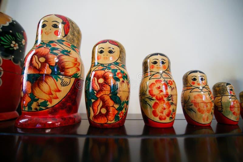 Matrioska traditional russian wooden dolls. Colorful Matrioska traditional russian wooden dolls in a row stock image