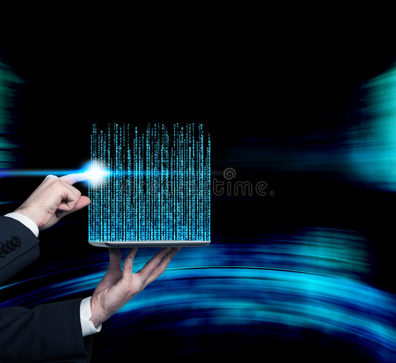 Matrix code. Hand touching touch pad with matrix code stock photo