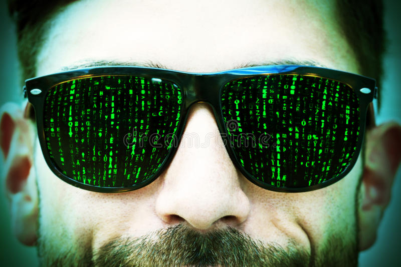 Matrix on glasses. Man with matrix signs on sun glasses royalty free stock photography