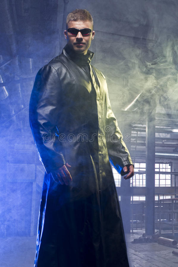 Matrix Style Role Play Character Adult Man. In Trench Coat in old factory stock image