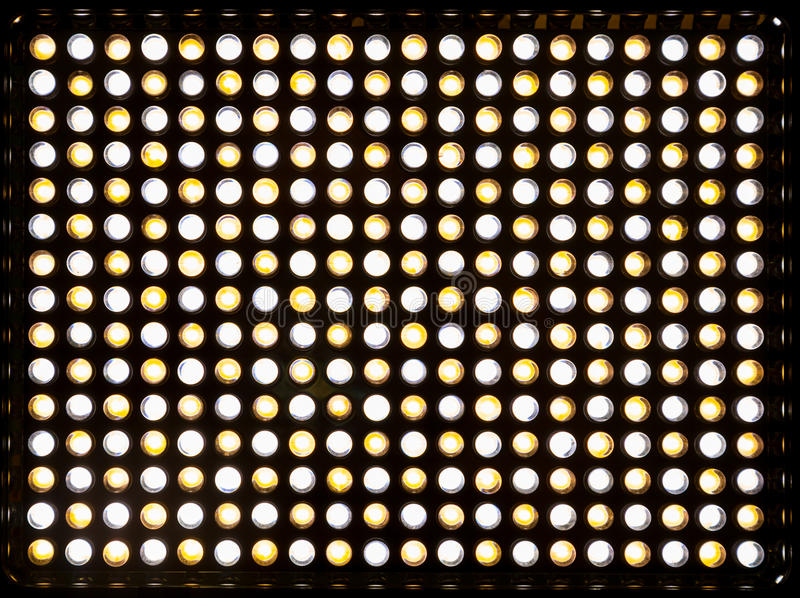 The matrix 300 yellow and white LEDs. Lighting device with variable color temperature Kelvin 3200-5500. Powered by a rechargeable royalty free stock image