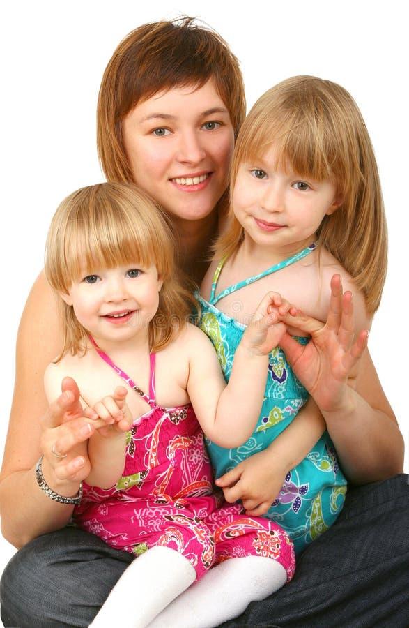 Matriz com duas filhas fotografia de stock
