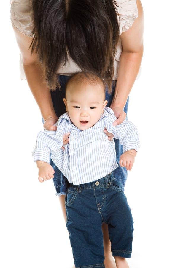 Matriz e bebê asiáticos imagem de stock