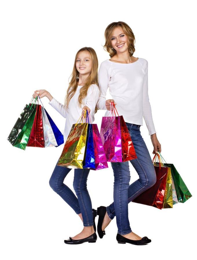Matriz e filha com muitos sacos fotografia de stock
