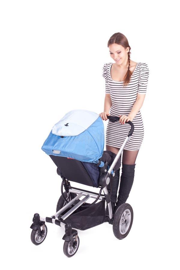 Matriz nova com buggy de bebê (carrinho de criança) imagens de stock