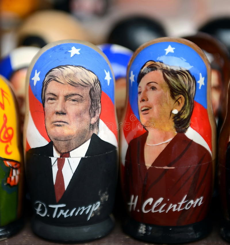 Matryoshka dolls with the image and the 45th President of the USA of Donald trump and Hillary Clinton on the counter of Souvenirs. MOSCOW, RUSSIA - MARCH 12 royalty free stock image