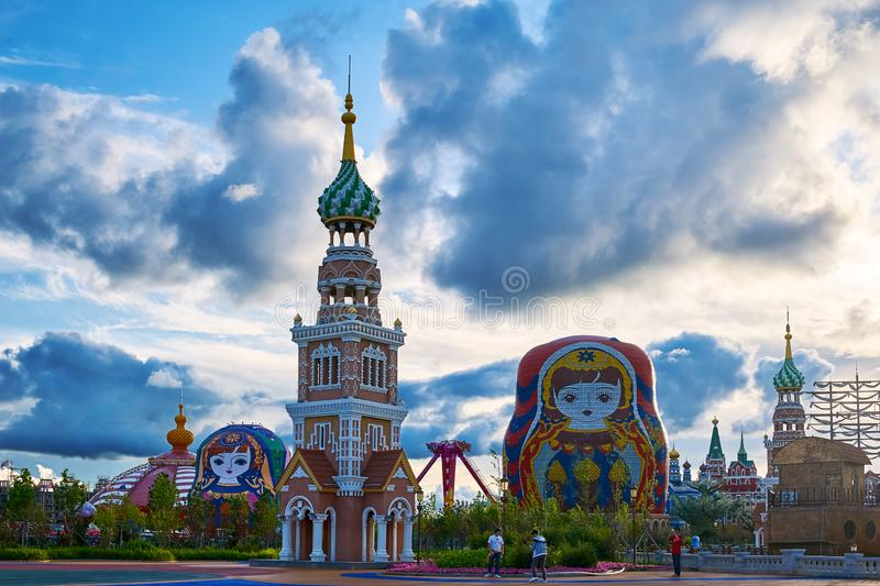 The matryoshka dolls and tower in the NZH Manzhouli city,China. The photo was taken in Matryoshka doll square of NZH Manzhouli in Inner Mongolia, China stock image