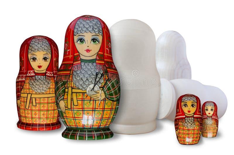 Matryoshka Pintado y sin pintar Aislado en blanco fotos de archivo libres de regalías