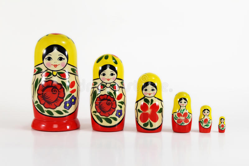 Matryoshka Russian Nesting Dolls. Isolated shot Russian Matryoshka nesting dolls (Babushkas) with copy space. All the dolls lined up in a row from tallest to stock photo