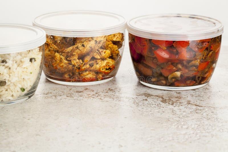 Matställemål i glass behållare arkivfoton