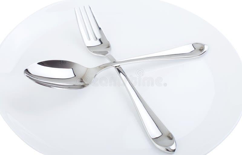 Matställeplatta, sked och gaffel. arkivbild