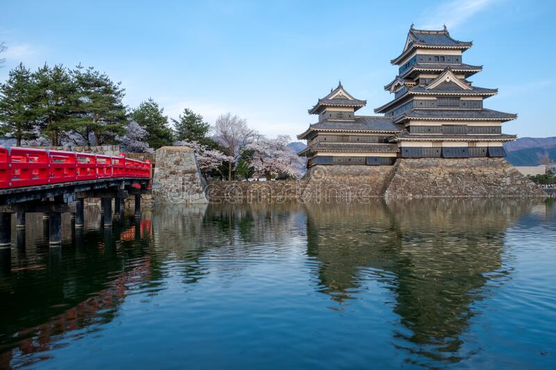 Matsumoto castle water reflection in evening time with sakura tree around against blue sky background, castle shadow on water,the. Castle famous historic, known stock images