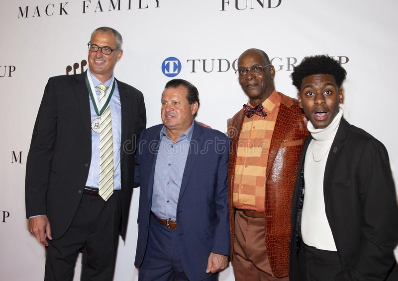 Matt Biondi, Mike Eruzione, and Bob Beamon at 34th Annual Great Sports Legends Dinner royalty free stock image
