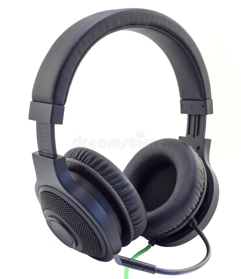 Matt black headphones with a headset with a green wire cuted isolated. On white stock photos