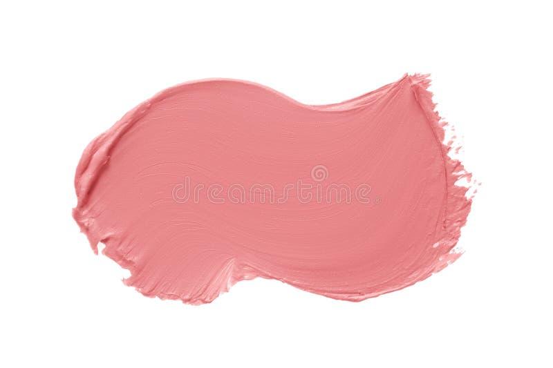 Matt läppstift Smeta ut en rosa krämfärgad produktsfärg som är isolerad på vit bakgrund arkivfoto