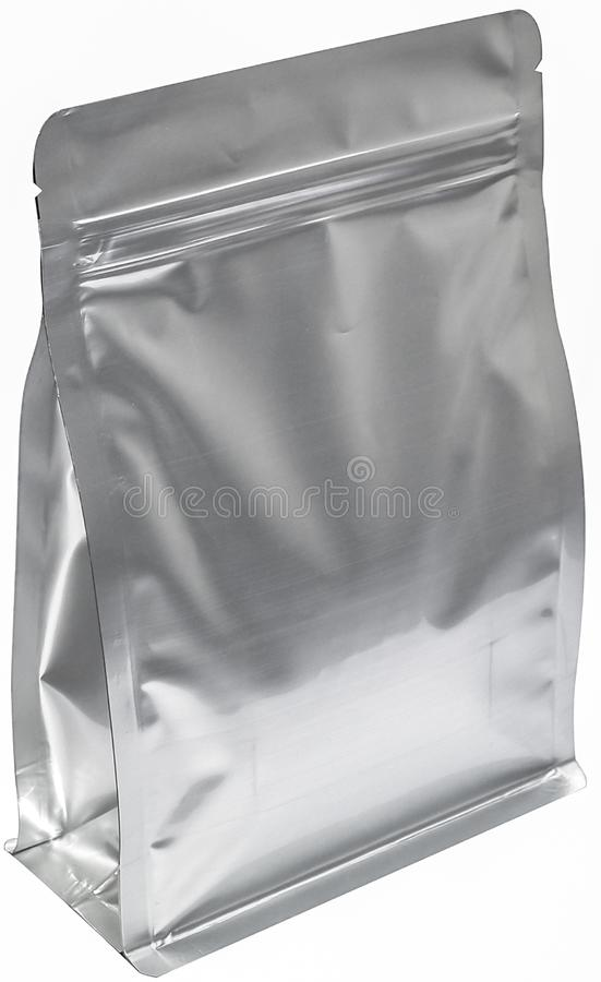 Matt silver aluminium flat bottom food pouch  with zipper  filled with coffee beans on white background fron view. Silver aluminium flat bottom food pouch with royalty free stock photo