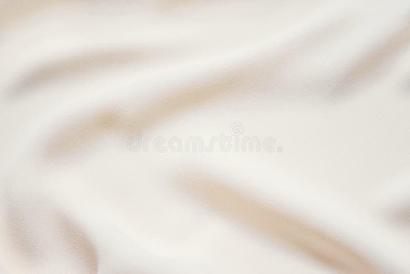 Matte kremowej miękkiej części tkaniny pofałdowany tło Gładka elegancka luksusowa sukienna tekstura Delikatny pastelowego koloru  zdjęcia stock