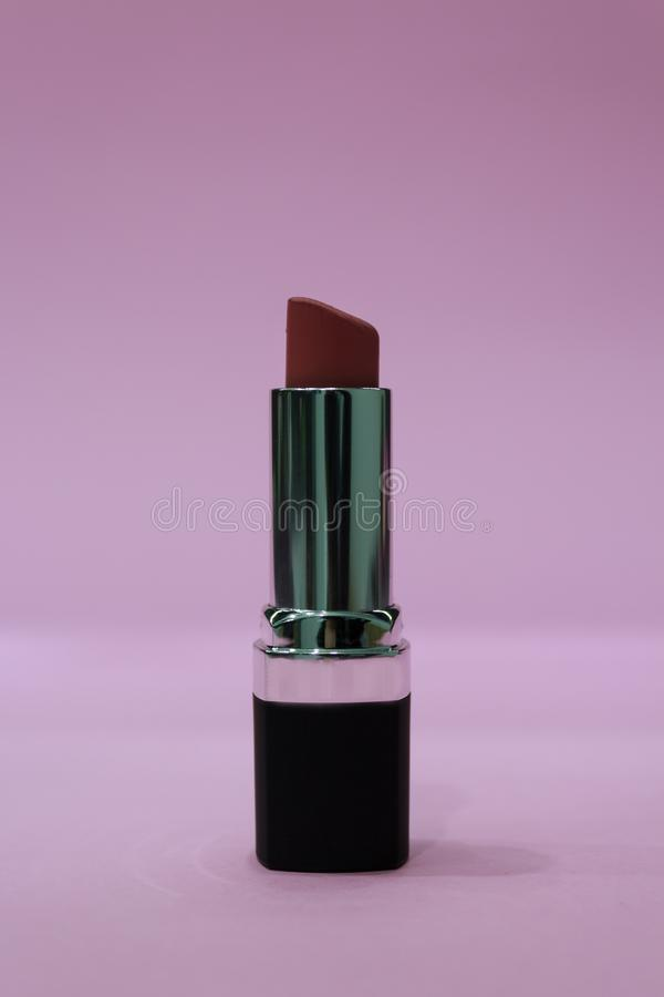 Matte lipstick on pink background royalty free stock photo