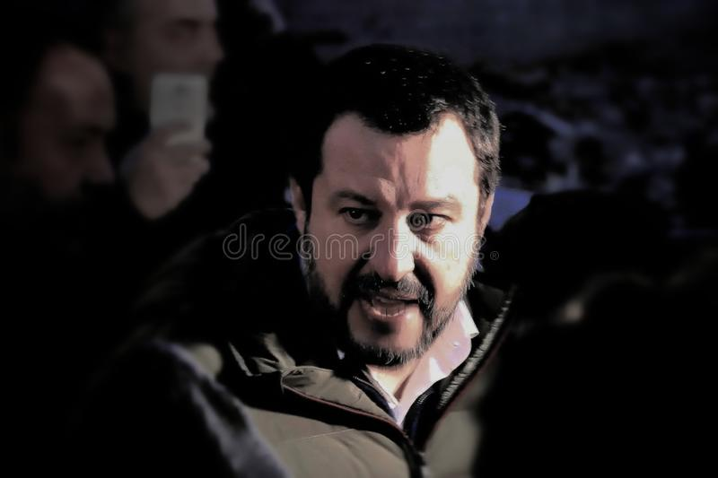 Matteo Salvini leader of italian Lega Party and nowadays Minister of Internal Affairs meet supporters during electoral rally. Visiting rom camp graphic grain stock image