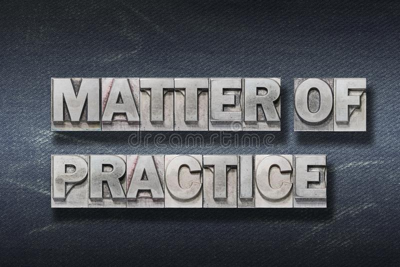 Matter of practice den. Matter of practice phrase made from metallic letterpress on dark jeans background stock photography
