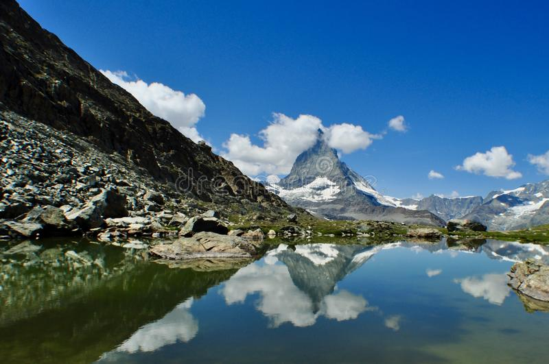 The Matterhorn. In the cloud reflecting on the lake stock image