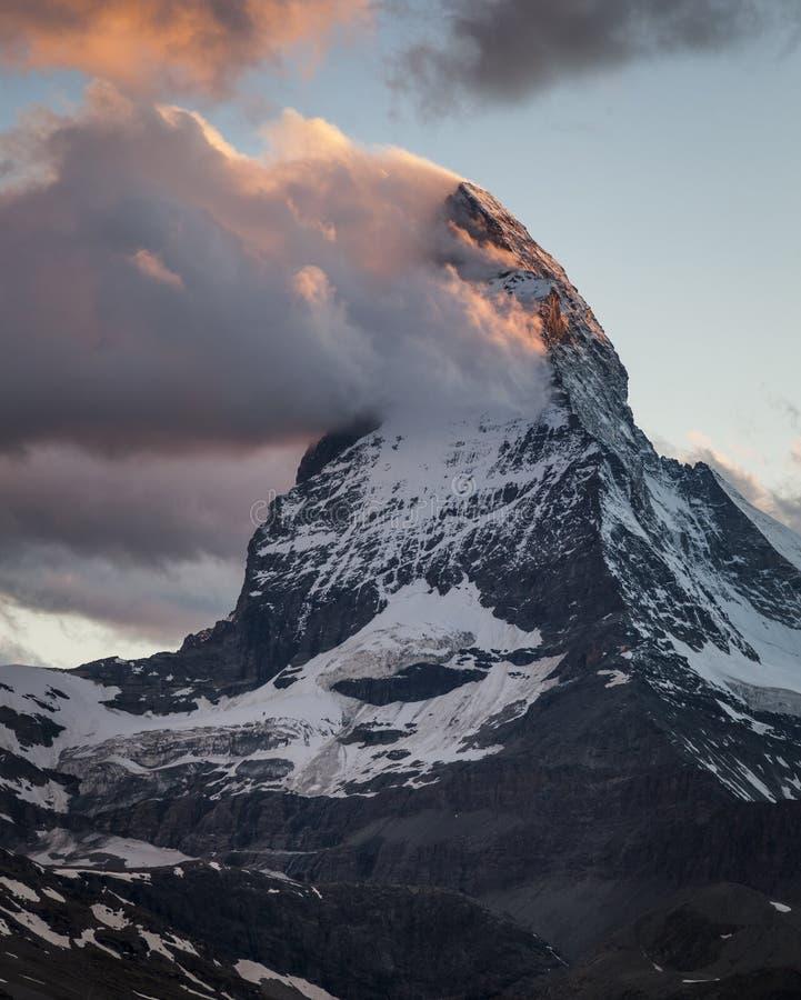 Matterhorn. The Matterhorn with clouds at dusk, Pennine Alps, Valais, Switzerland, Europe stock photo