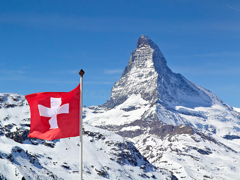 Matterhorn with flag of switzerland. The famous Matterhorn with the flag of switzerland in the foreground stock photography