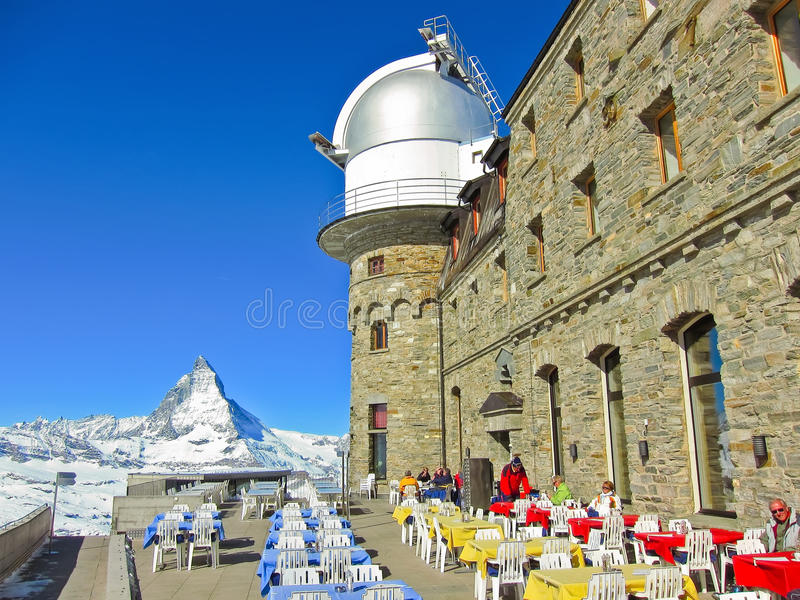 Matterhorn and the Gornergrat Kulm Hotel in Gornergrat, Zermatt. Ermatt, Switzerland - March 22, 2011: View of Matterhorn and the Gornergrat Kulm Hotel at 3,120 royalty free stock images