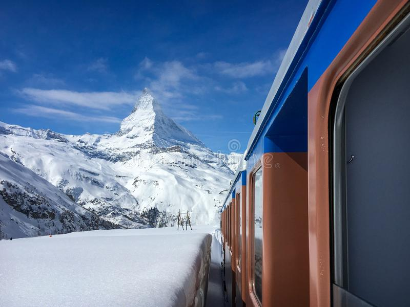 Matterhorn mountain and alpine landscape with Gornergrat railway. Matterhorn mountain and landscape of Swiss around Zermatt seen from driving Gornergrat railway stock images