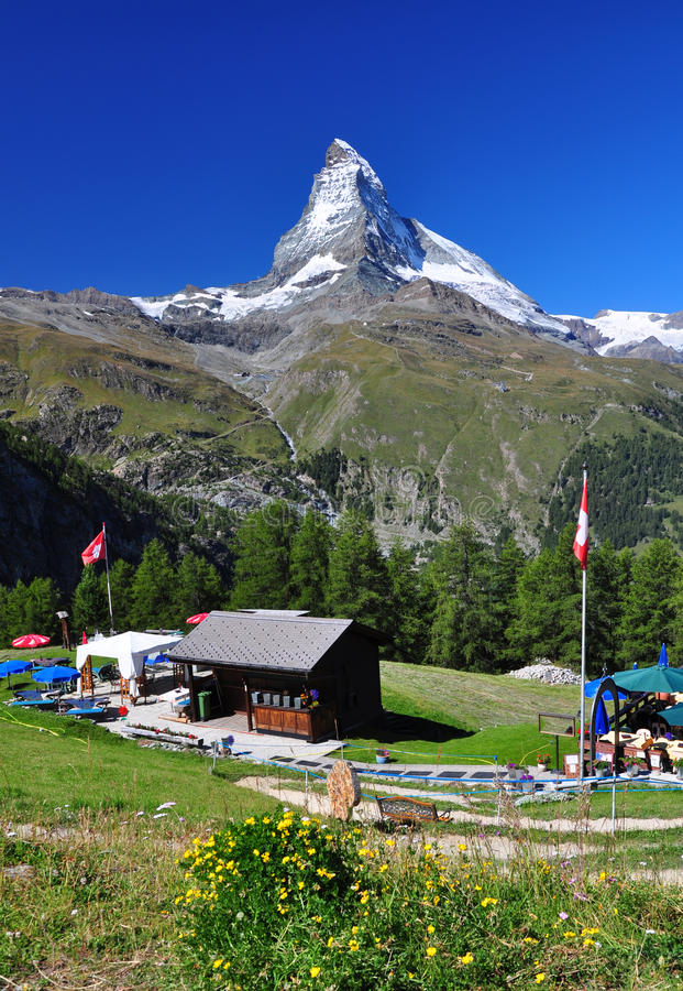 Matterhorn peak and a chalet royalty free stock images