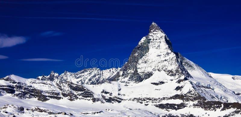 Matterhorn peak at Gornerg. Matterhorn peak, logo of Toblerone chocolate, located at Gornergrat in Switzerland royalty free stock photo