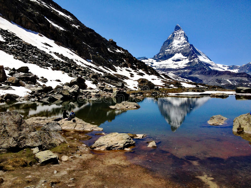 Matterhorn Peak reflection in summer at Riffelsee lake, Gornergrat station, Zermatt, Switzerland.  stock photography