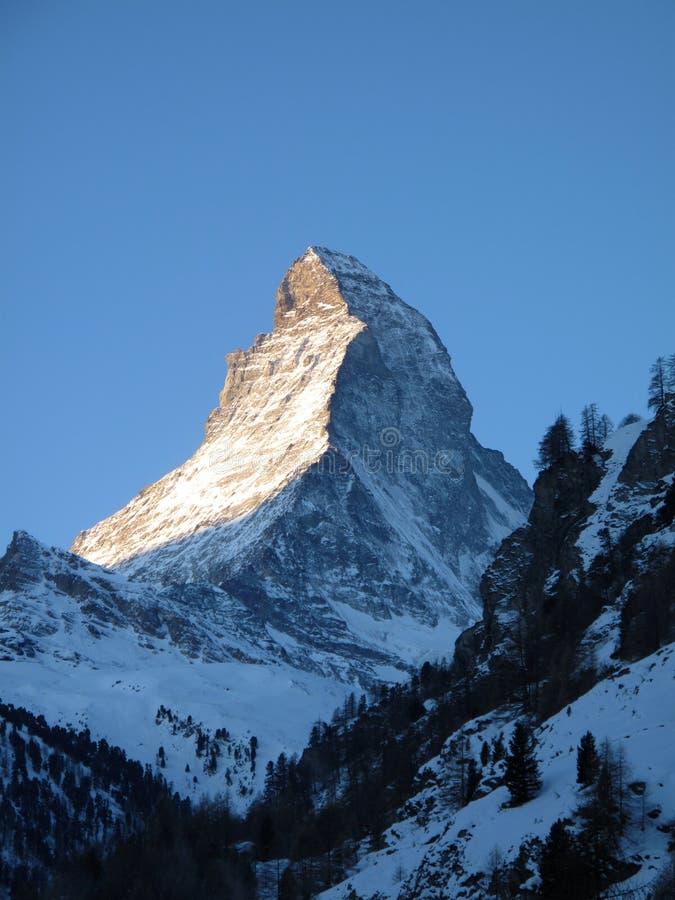 Matterhorn summit. Summit of Matterhorn in the Swiss Alps, north- and east face stock photo