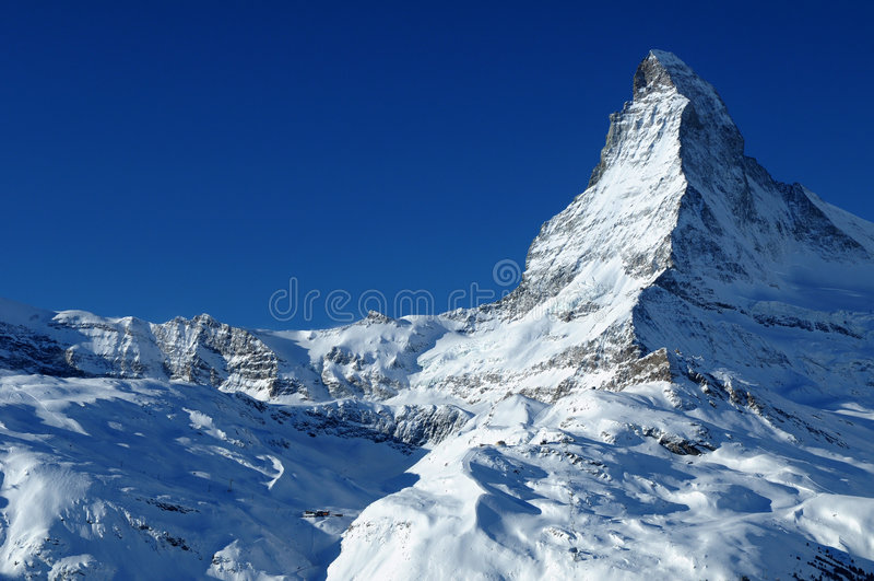 Matterhorn summit. The snow capped summit of the Matterhorn in Switzerland royalty free stock image
