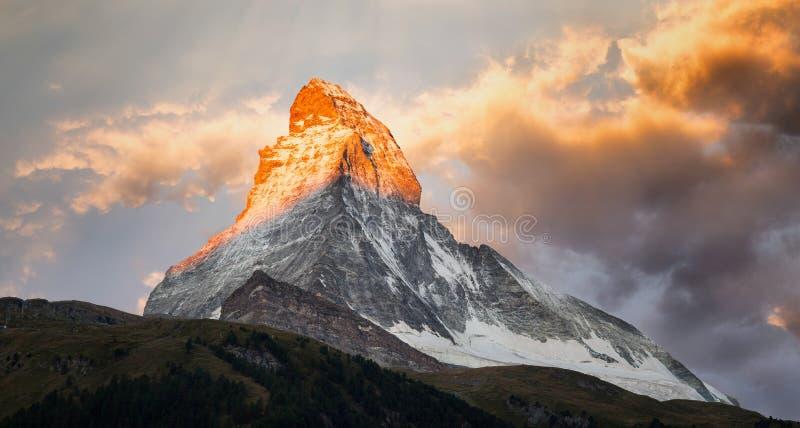 Matterhorn Sunrise. A beautiful sunrise with alpenglow on the peak of the Matterhorn stock images