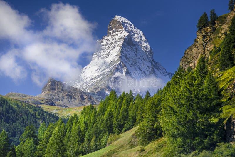 Matterhorn. View of Matterhorn peak surrounded by green landscape above Zermatt, Switzerland. (landscape orientation royalty free stock photos