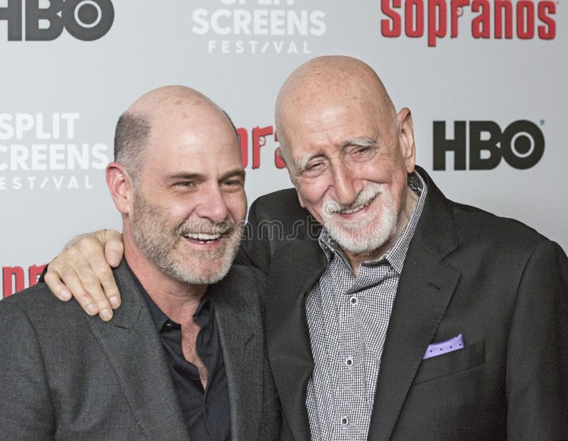 Matthew Weiner and Dominic Chianese Attend The Sopranos Reunion. Matthew Weiner, Executive Producer and writer, embraces actor and singer Dominic Chianese as the royalty free stock photo
