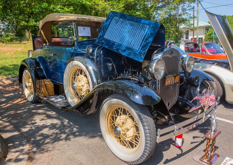 1930 Ford Roadster Automobile. MATTHEWS, NC USA - May, 12, 2018: A 1930 Ford Roadster on display at the Cruisin` Car Show, part of the Matthews Beach Fest royalty free stock photo
